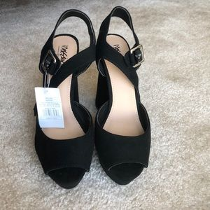 Black suede peep toe heels